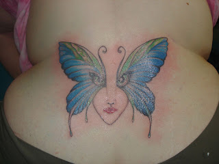 butterfly with angle eyes on lower back