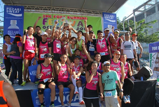 TPB hoists the trophy at last year's October Running Fest as the 21K team Champions
