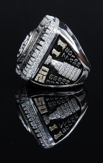 A side-view of the 2010-2011 Boston Bruins Stanley Cup champions ring, which has all of the years that the Bruins have won the Stanley Cup