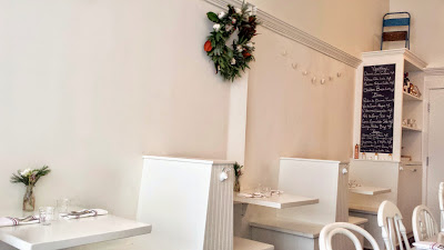 Atmosphere at Maurice is usually very clean and simple, the wreath is an addition just for the holidays, and you can see more of the carefully selected wine list on the chalkboard there