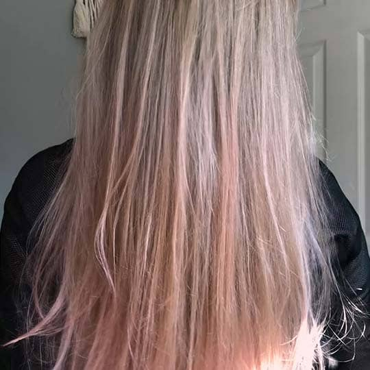 A woman with subtle blonde to pink hair
