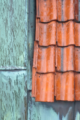 roof tiles and metal sheeting in the rain