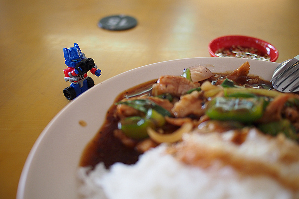 Kreon Optimus Prime taking a picture of food
