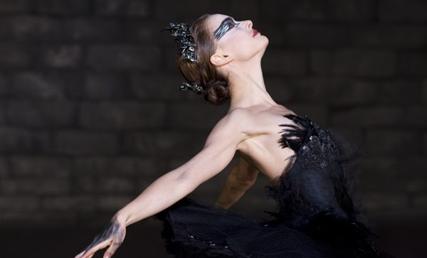 a Black swan, the black feathers getting out from the skin and the wings