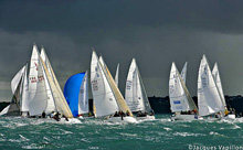 J/80s sailing around windward mark off France