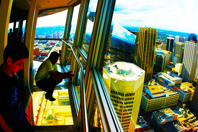 Looking down 1,228 meters onto downtown Calgary from the Calgary Tower's glass floor observation deck.