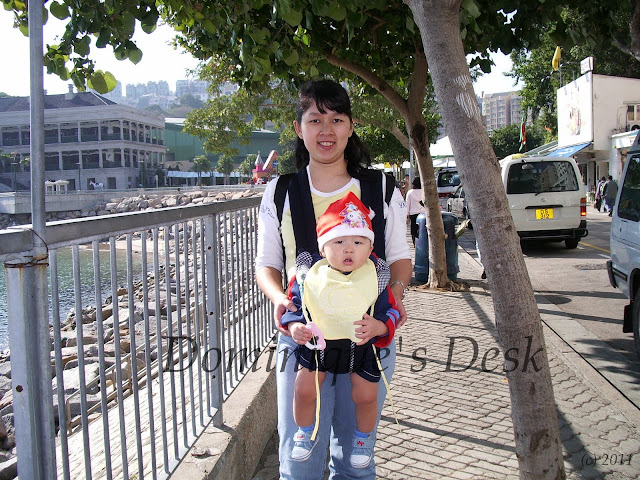 On the streets of Stanley, Hong Kong when Monkey boy was a baby