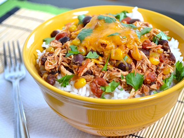 These Slow Cooker Taco Chicken Bowls are as easy as 1-2-3. The recipe makes a big batch, but leftovers will get eaten fast! BudgetBytes.com