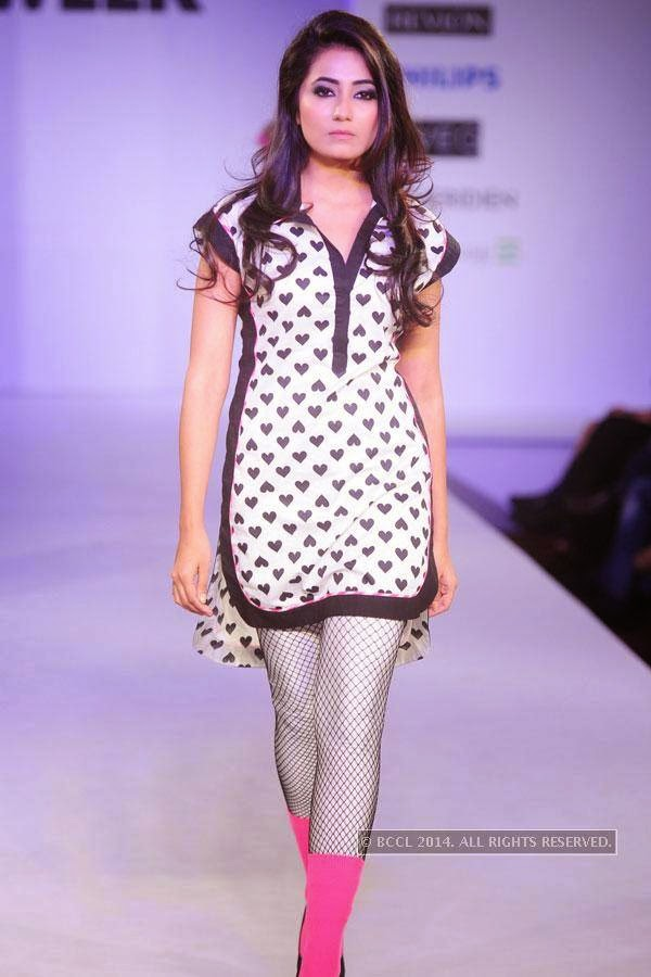 A model walks the ramp during Jabong Online Fashion Week, held at Hotel Le Meridian, in Delhi, on July 30, 2014.