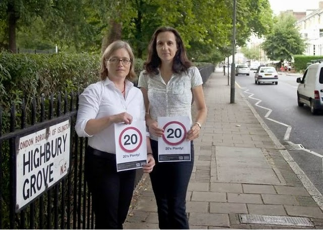 @ Women holding 20MPH Signs