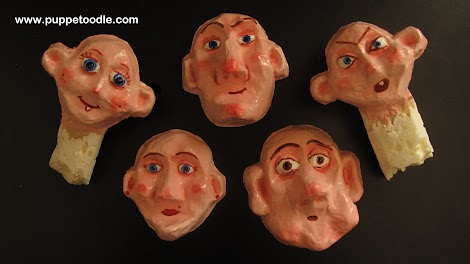 Here are the finished painted and varnished faces