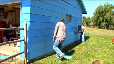 Bighorn Canyon Chief of Interpretation, Ken Woody, and DOI/VISTA, Josh Little Owl, take part in a 9/11 Service Project by painting a retired Vietnam veterans home.
