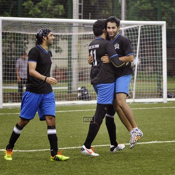 Abhishek Bachchan and Armaan Jain celebrate a goal during a charity soccer match organised by Aamir's daughter Ira Khan, at Cooperage ground, on July 20, 2014.(Pic: Viral Bhayani)
