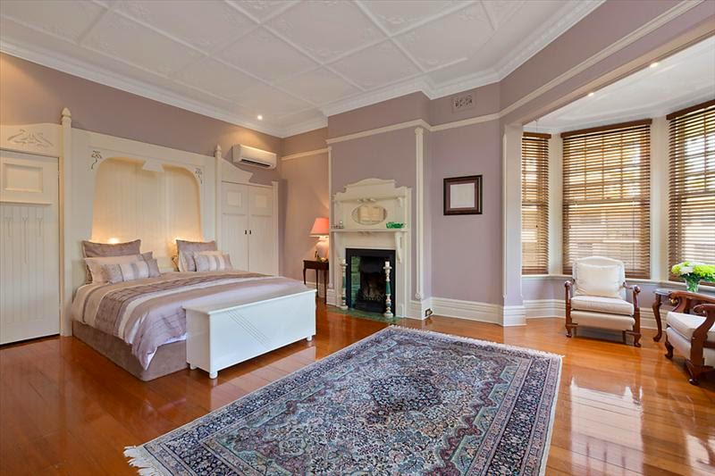 The ornate ceilings, picture rails, high skirting boards and bay window are exemplary of Federation Queen Anne style. The closets are also ornamental in a flowing Art Nouveau design, very unusual to have built-in wardrobes, let alone designed with such beautiful decorative style.