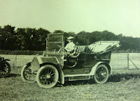 "Dr Margoris (in practice 1890 to 1926) in 1907. This 1906 Humber passed on to Merrick Bagnall at the Red House in Newton Road. Then Mrs Firella Altham bought it whenshe came to live at the Lodge during WW1. John Altham and his sister  with children frequently went to London in it when their mother went shopping, mainly to Selfridges. ""In Welwyn village, my mother made us walk up the hill in case the car couldn't climb up."""