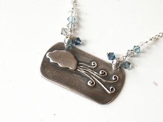 stormy sky cloud wind swirls handmade silver pendant