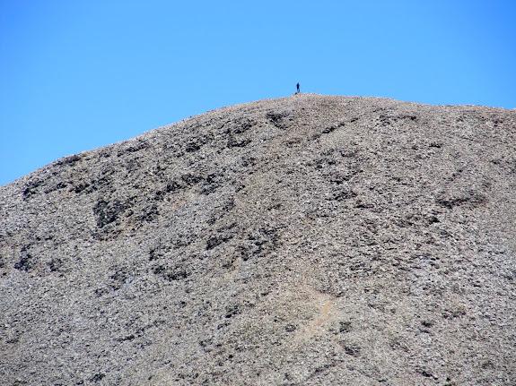 A hiker atop Mt. Waas