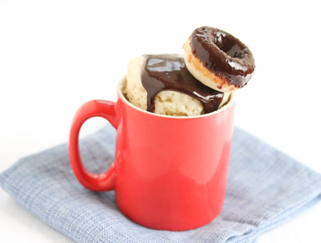 photo of donut mug cake topped with a mini glazed donut