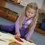 Montessori preschool girl in Huntington Beach working with geometric material.