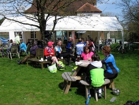 cyclists in sunny pub garden