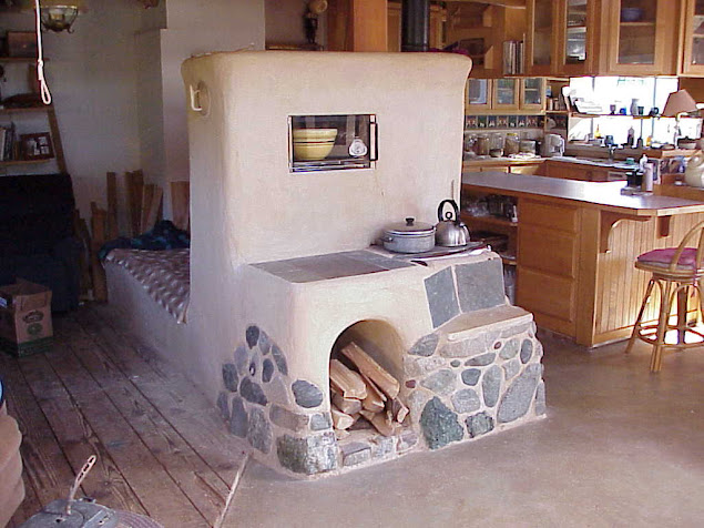 Beautiful rocket mass heaters rocket mass heater forum at for Rocket stove inside fireplace