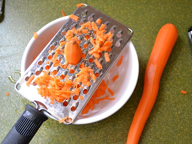 peel and grate carrot into bowl