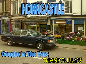 Limousine outside flowershop with message Horncastle caught in the past, thankfully
