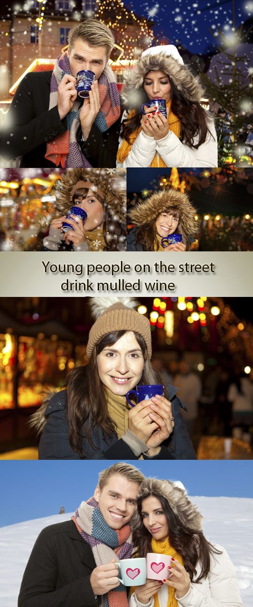 Stock Photo: Young people on the street drink mulled wine