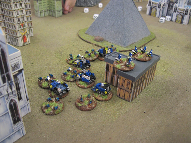 Death Skulls race to protect the pointy building.