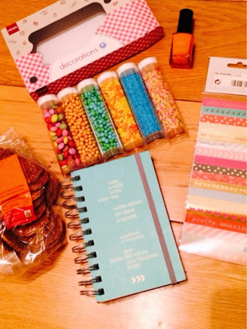 HEMA cake sprinkles, stickers, note book, waffle biscuits, nail polish