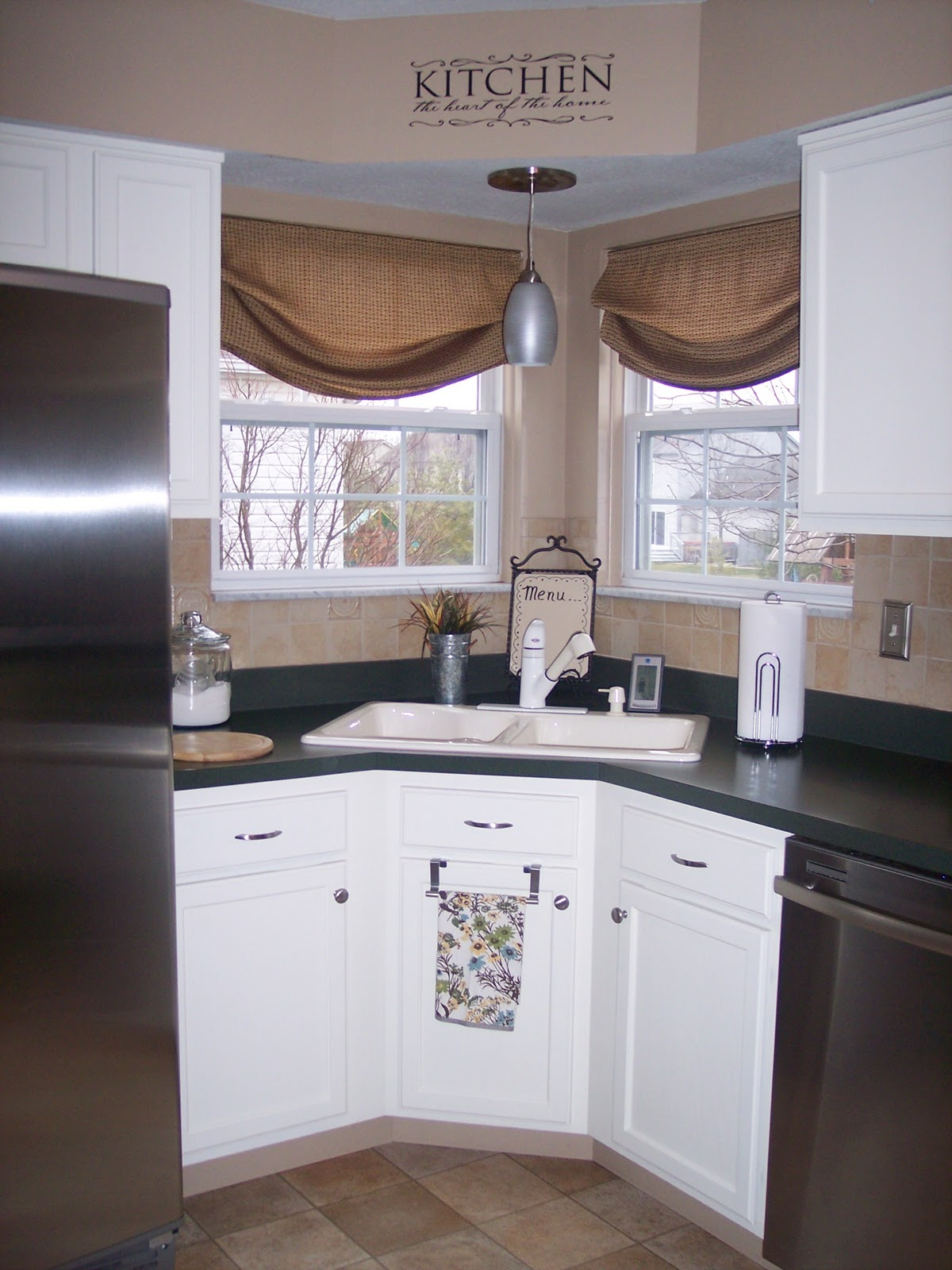 Painting Kitchen Cabinets! Check