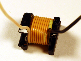 Inside the transformer of an iPad charger, This is the triple-insulated secondary winding.