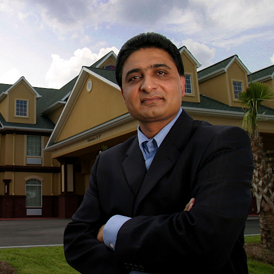 Danny Patel in front of one of his Best Western hotel properties in Georgia