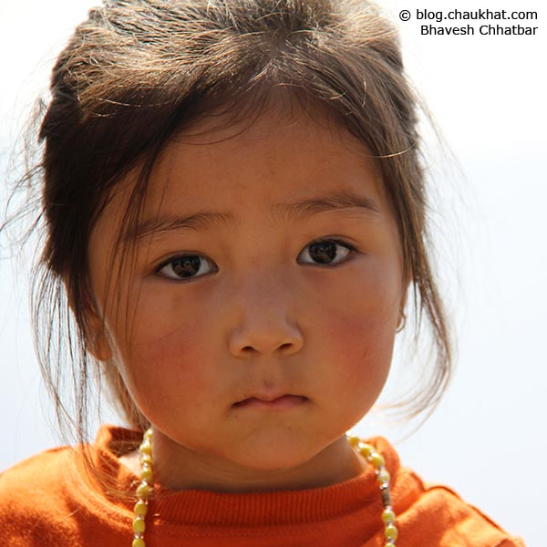 Close-up portrait of a super cute baby from high altitude, perhaps from Nepal