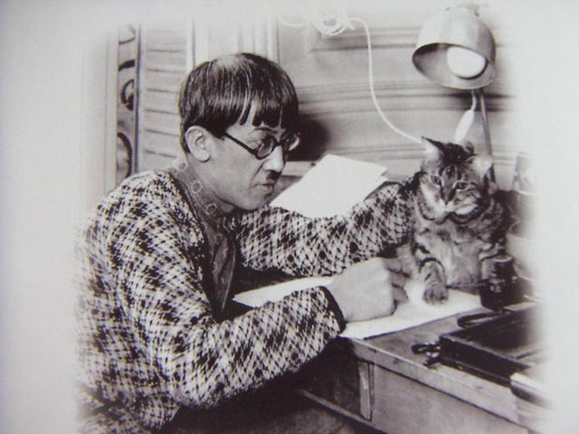 Leonard Fujita at work with a cat