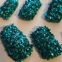 Unhas com flocos de glitter