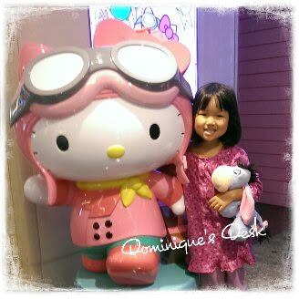 Tiger girl posing  with a statue of Hello Kitty which we spotted at the airport