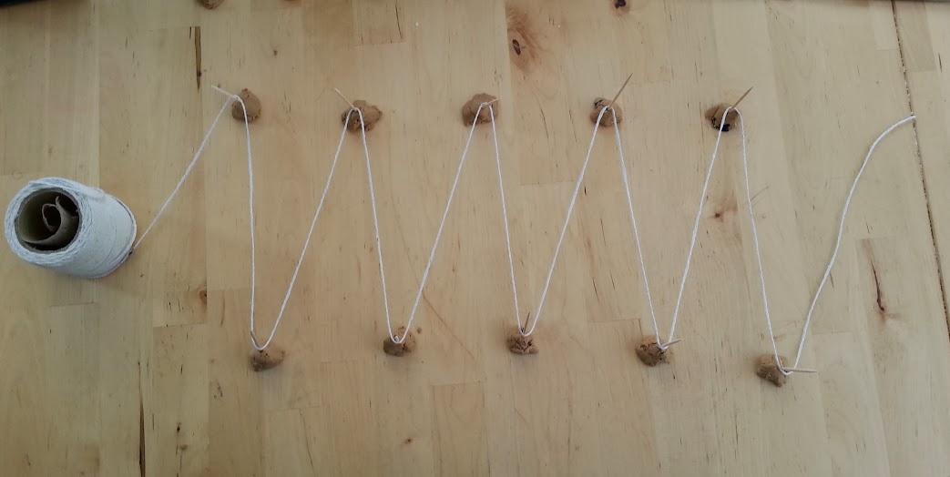 String and toothpick wave model