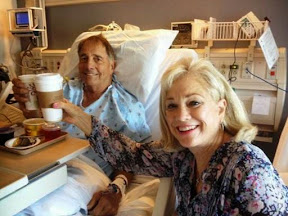 Dave and Rosemarie toasting with coffee that the surgery is over