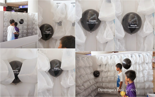 The kids testing out the Breathing Wall at the Philips Roadshow