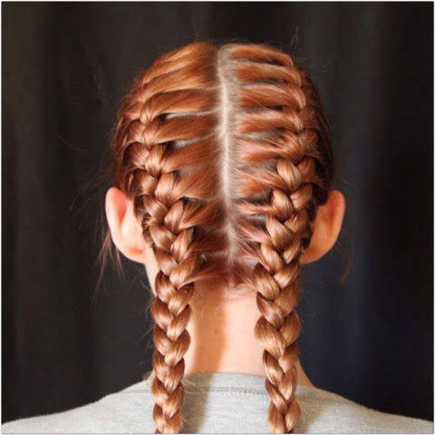 Do two french braids by parting the hair down the middle and braid