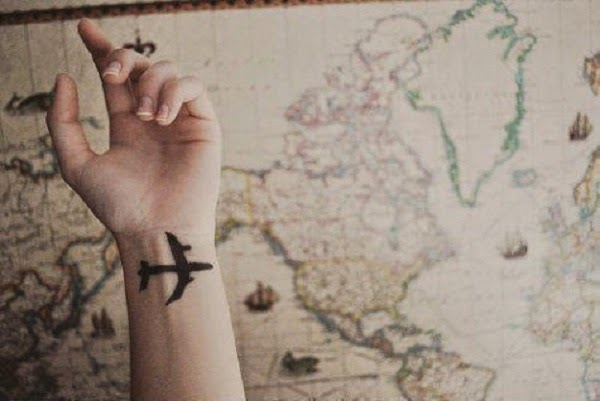 small aeroplane tattoo on wrist