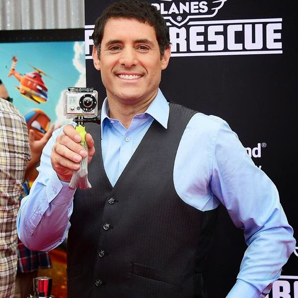 Donny Pardo, who voices Blackout, turns his Go-Pro camera on the photographers while posing on arrival for the world premiere of the film 'Planes Fire & Rescue' in Hollywood, California, on July 15, 2014.