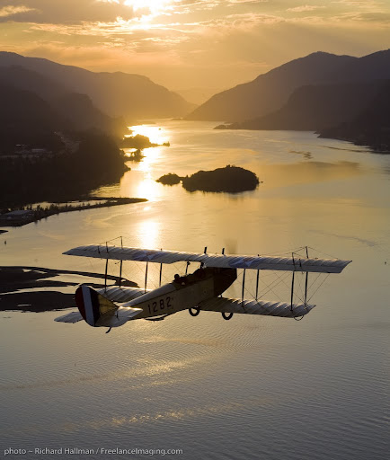 Western Antique Aeroplane and Automobile Museum's Curtiss Jenny flies over the mighty Columbia River.