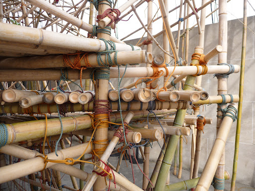 The bamboo poles are secured with rock-climbing rope.