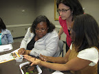 Early childhood educators examine the movement of earthworms.