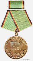 135 KVP Treue Dienste medailles