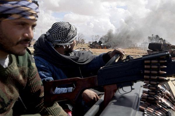 01/07/12 DOMINGO Rescate en Libia  - La Granja Airsoft - Partida abierta 0320-libyan-war-critics_jpg_full_600