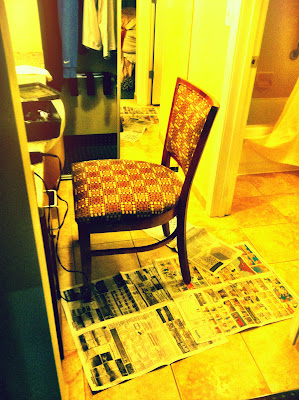 hotel chair hair cut bathroom newspaper floor stock photo
