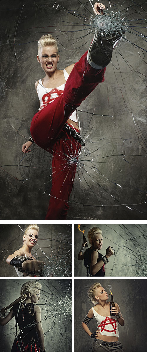 Stock Photo: Punk girl with a bat behind broken glass
